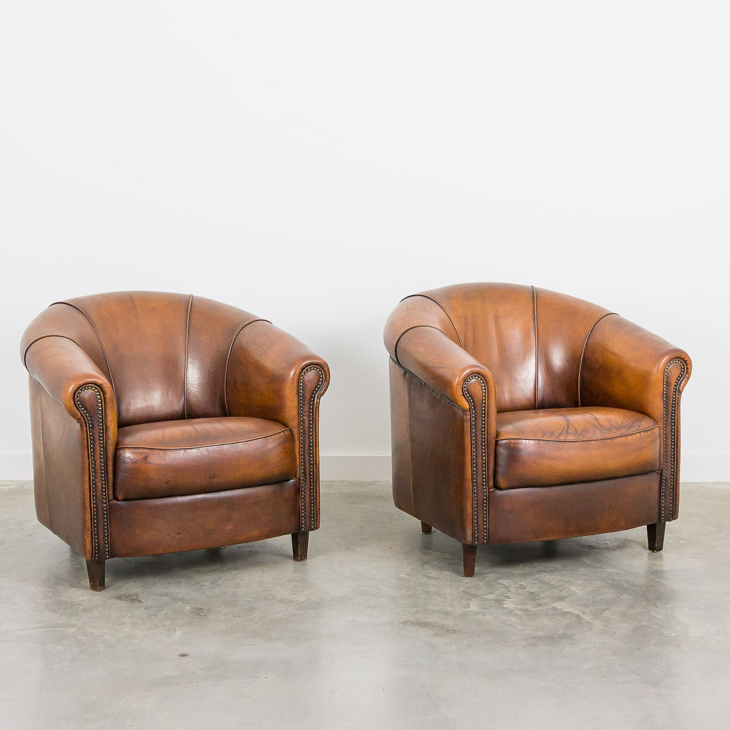 Vintage leather club armchair by Joris set of 2