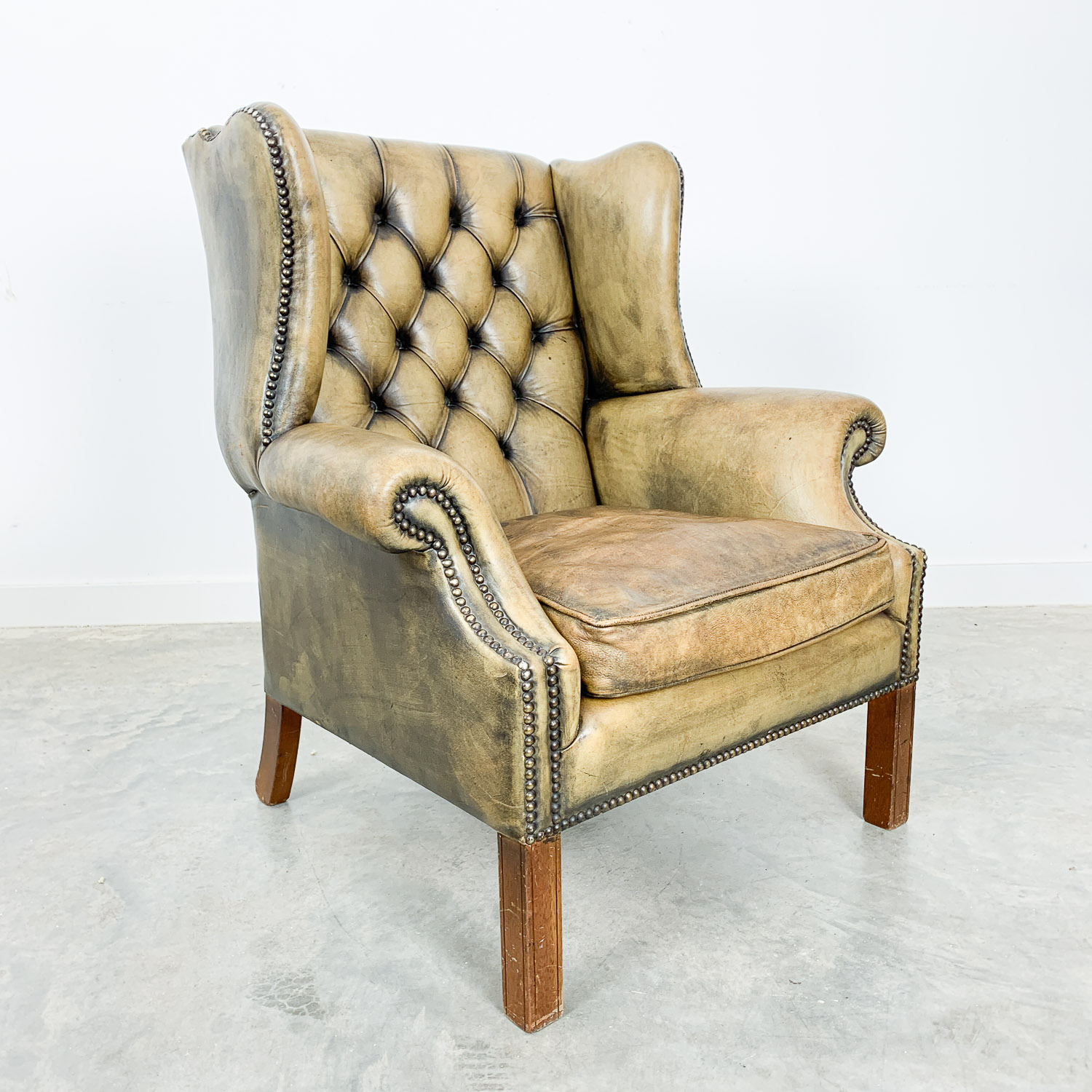 Chesterfield wingback armchair olive