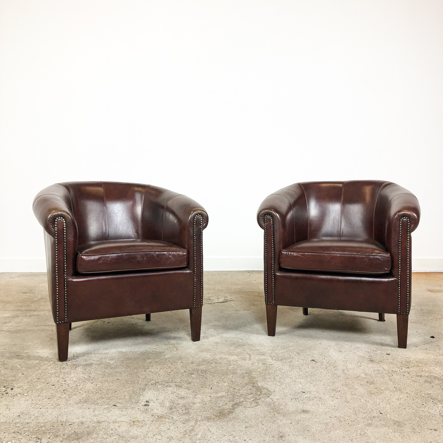Set of two dark brown sheep leather club chairs