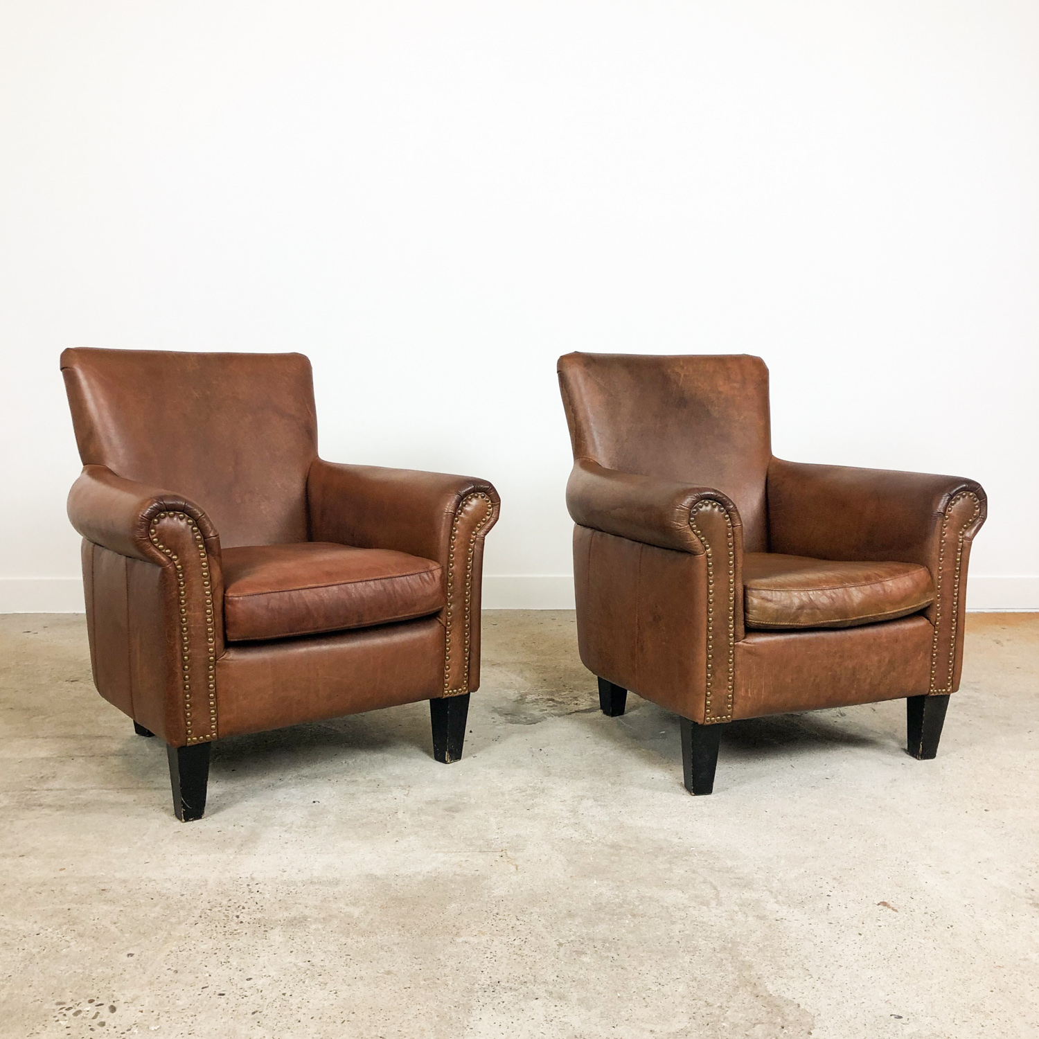 Set of two vintage leather armchairs