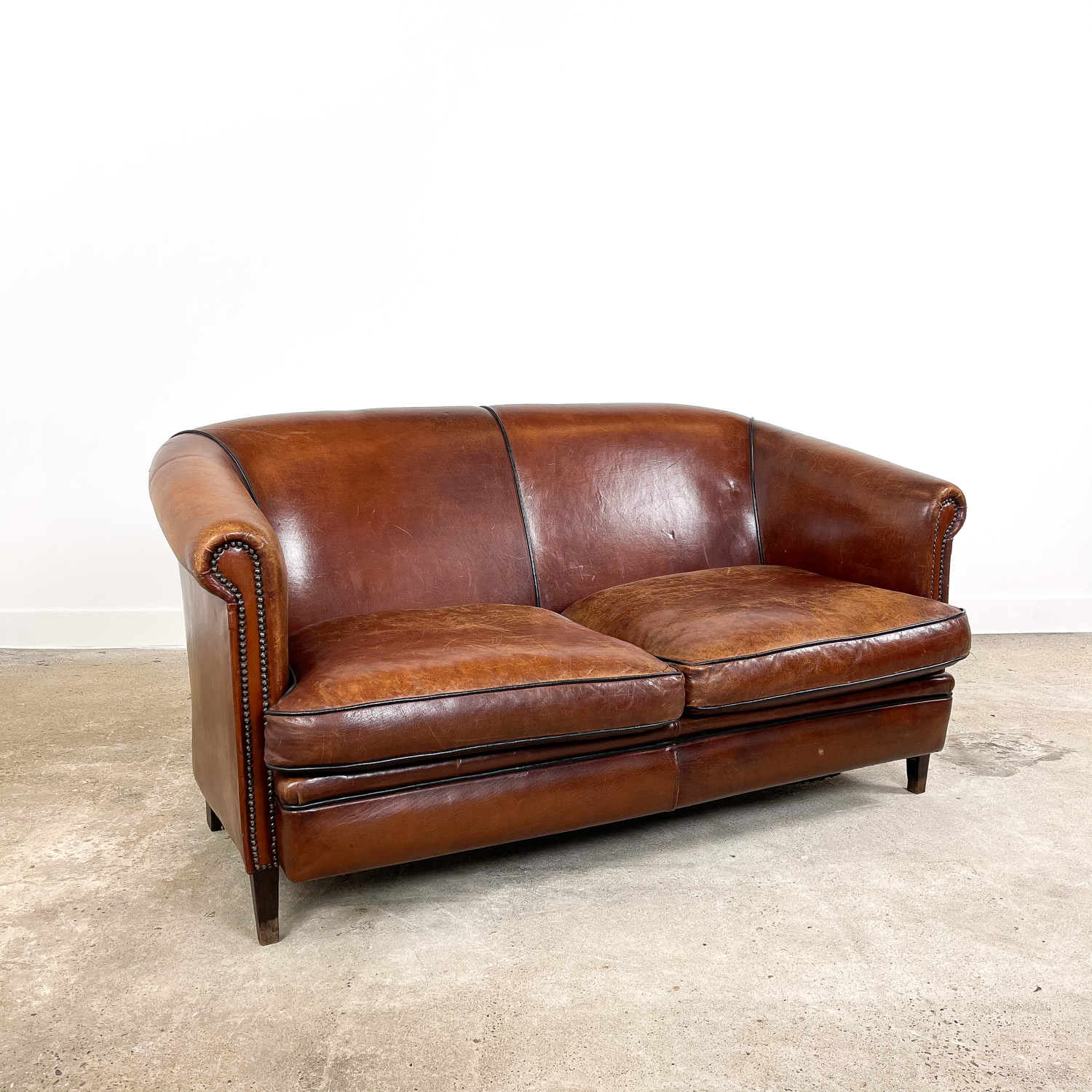 Vintage sheep leather club sofa two seater