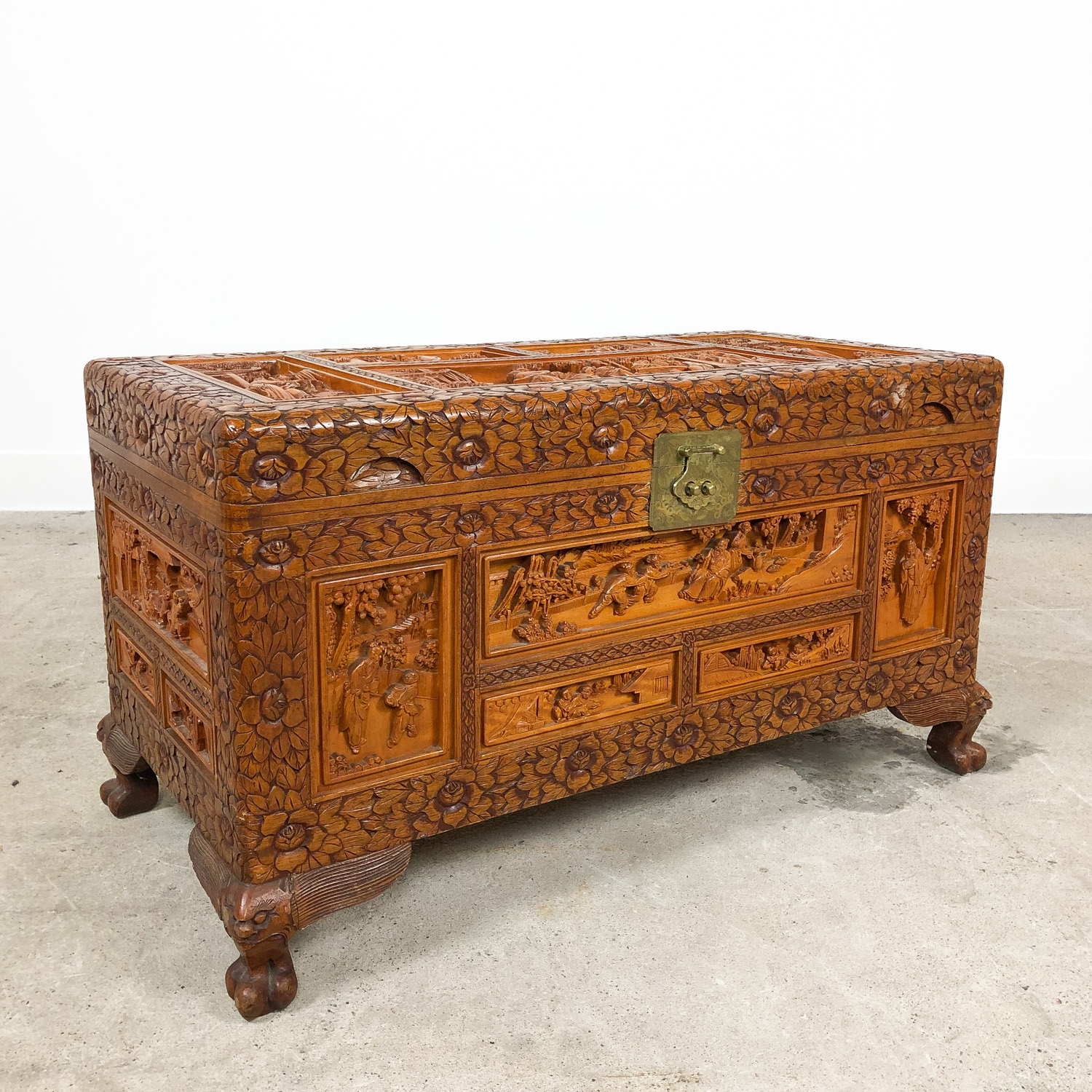 Vintage Chinese carved camphor wood chest on claw feet