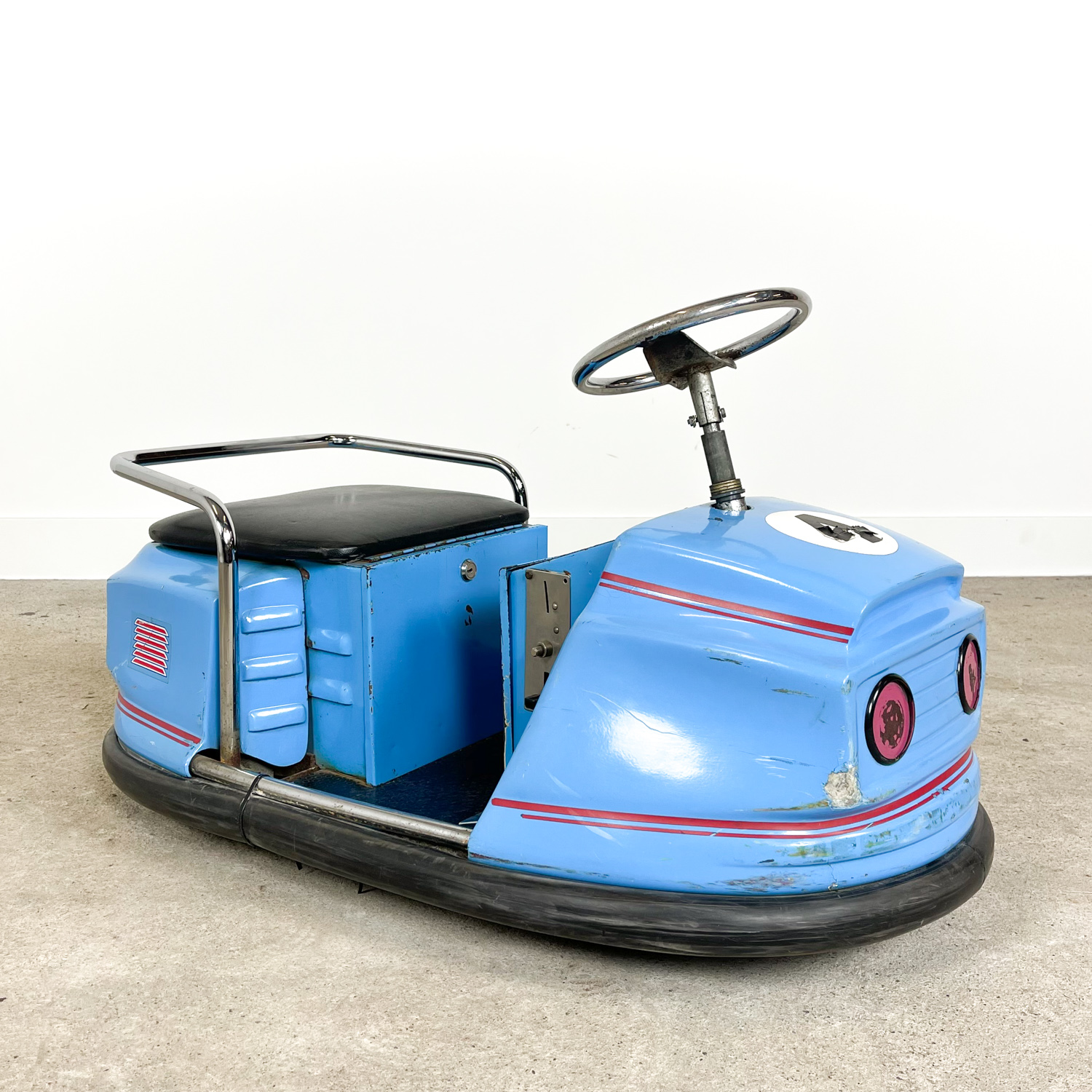 Small vintage electric auto scooter bumper car blue