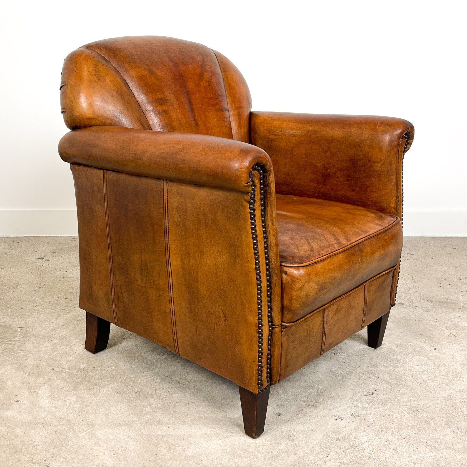 vintage cognac colored art deco style arm chair