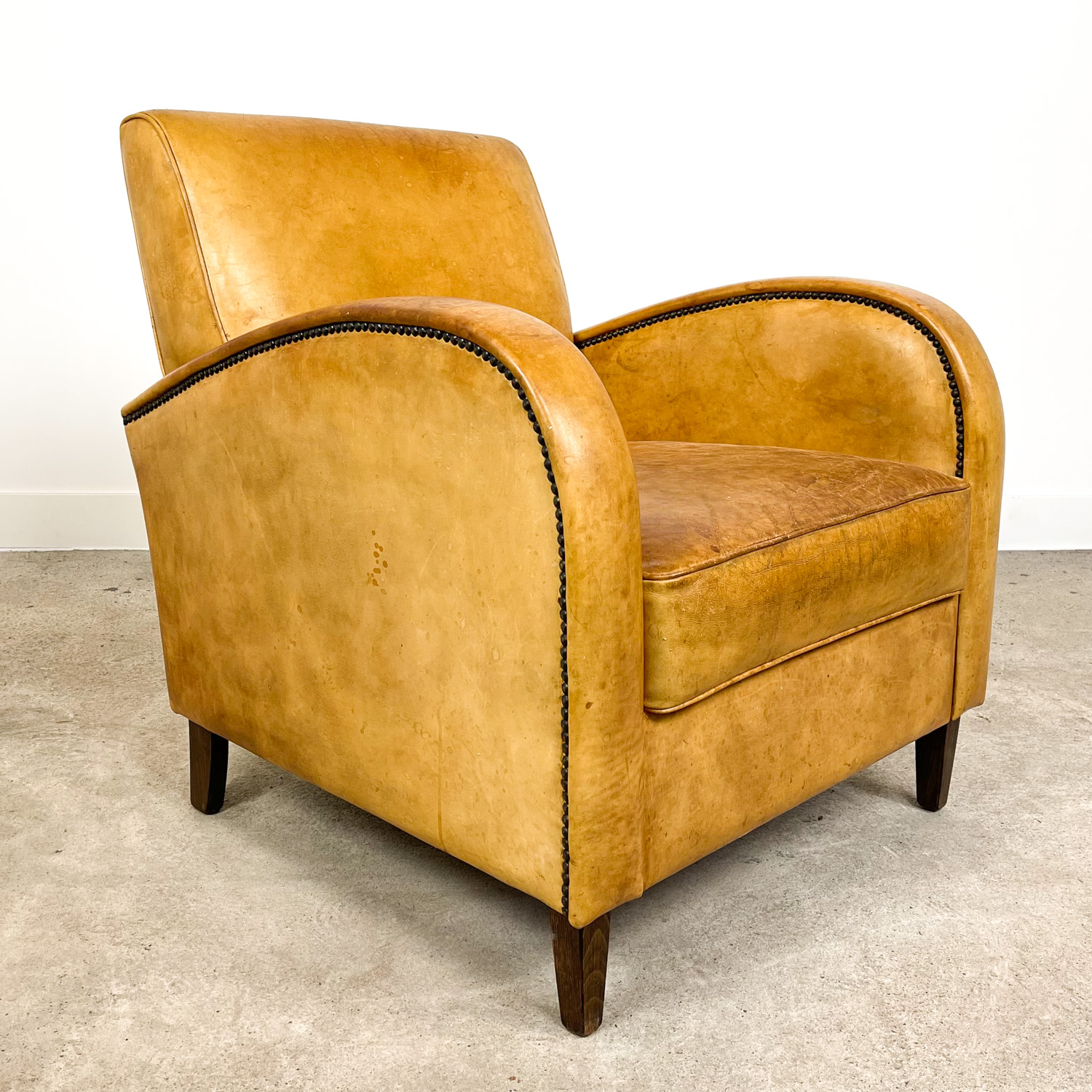 Vintage light brown sheep leather armchair
