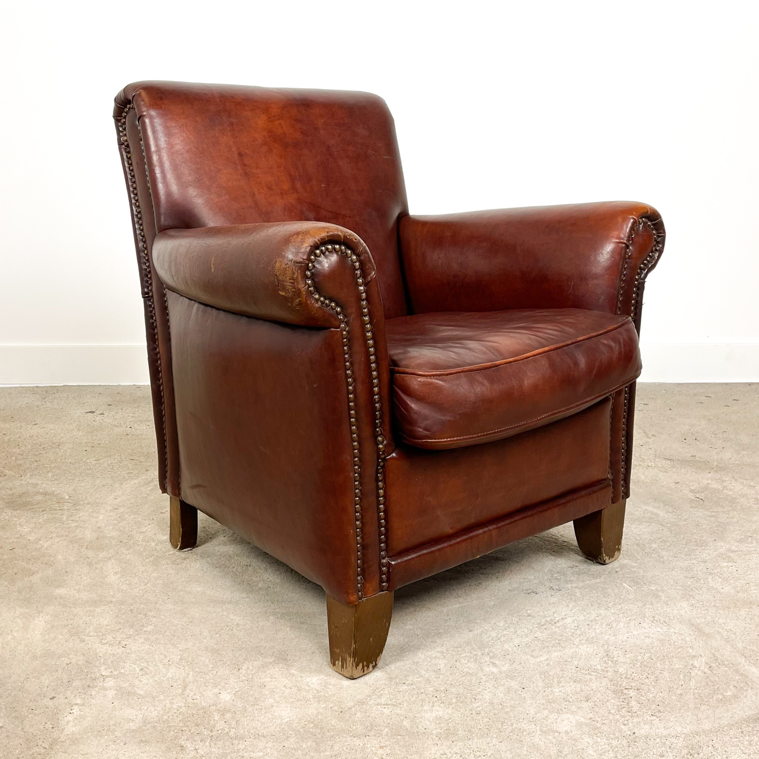Vintage dark brown sheep leather armchair