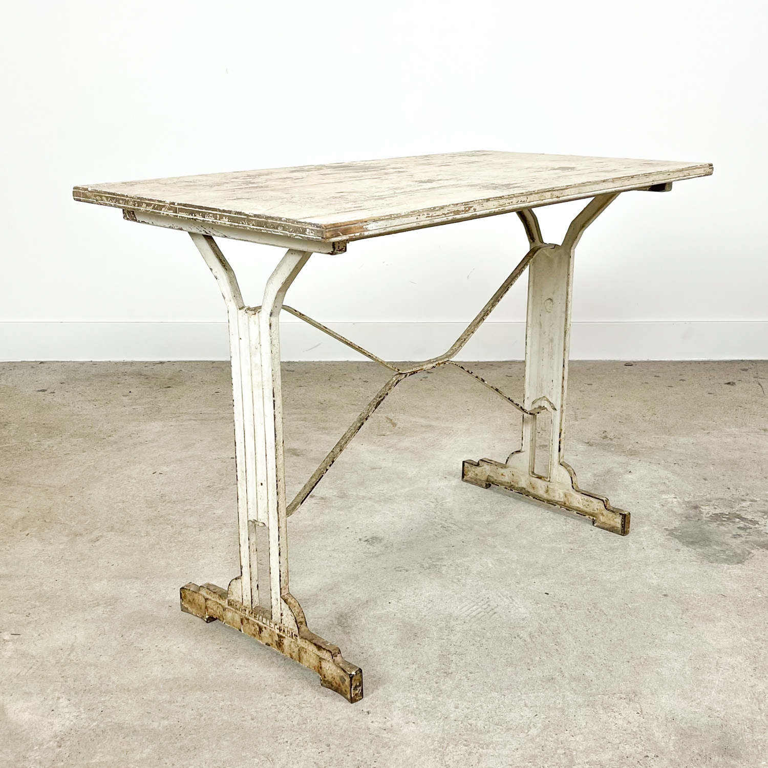 Antique white painted wooden bistro table by Martin Meallet paris
