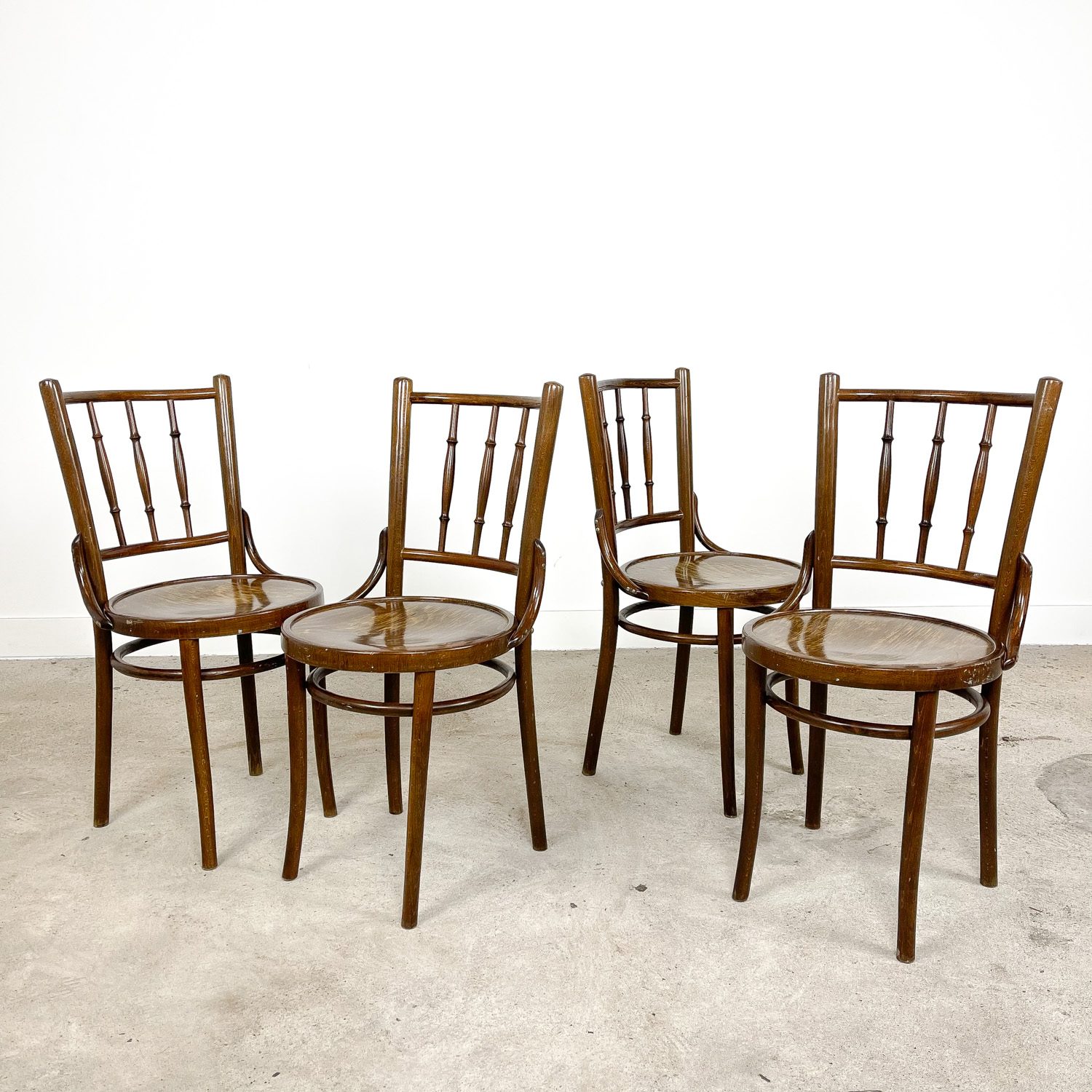 Set of four vintage wooden cafe bistro chairs