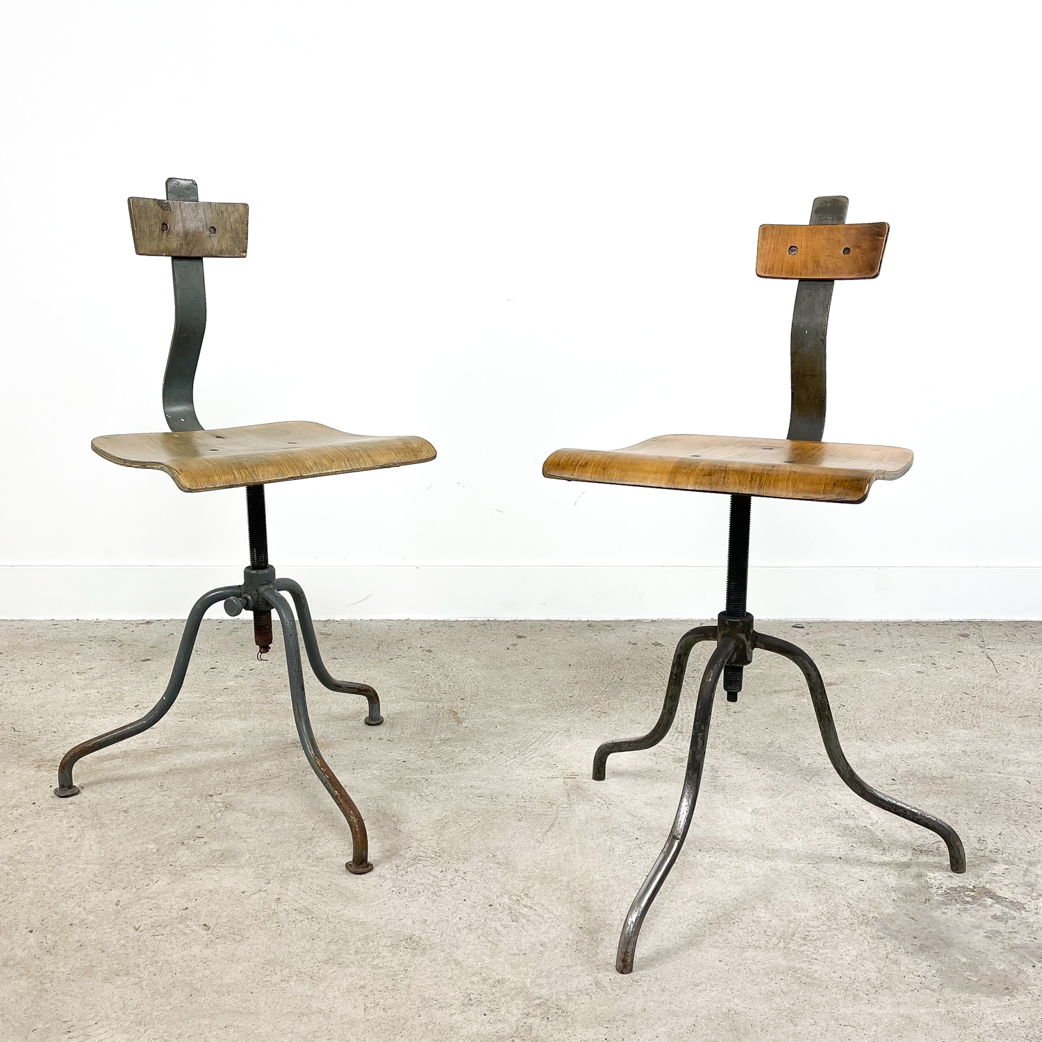 Pair of 2  Vintage industrial tripod factory chairs A