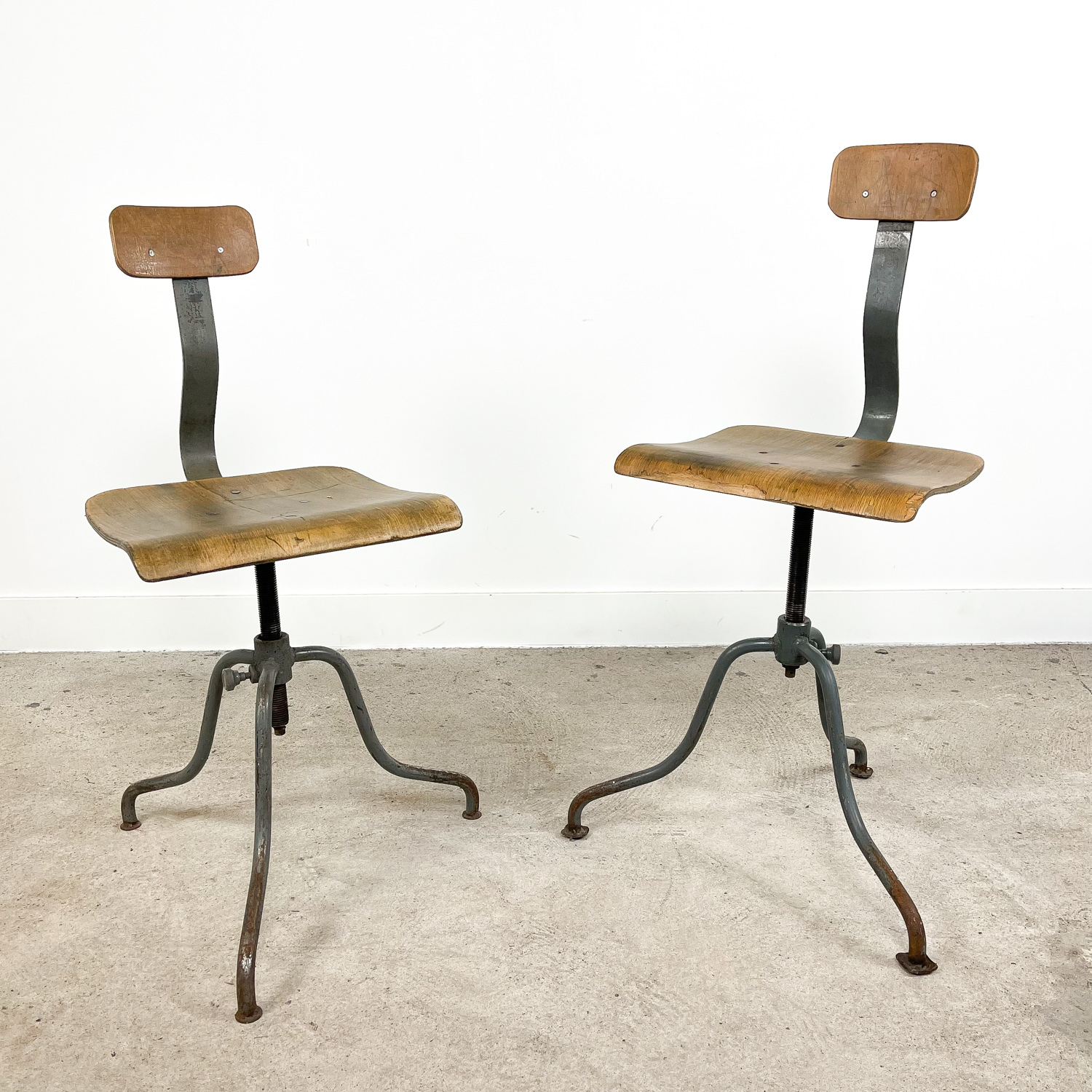 Pair of 2  Vintage industrial tripod factory chairs B