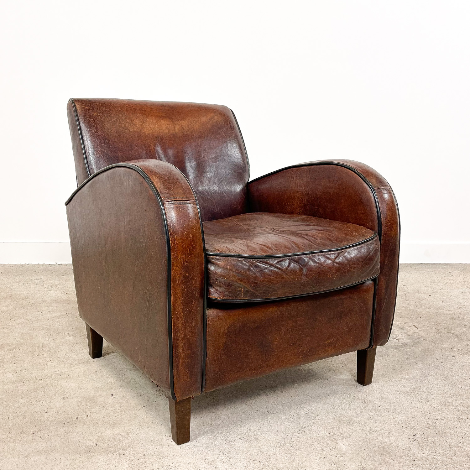 Vintage sheep leather wagon wheel armchair
