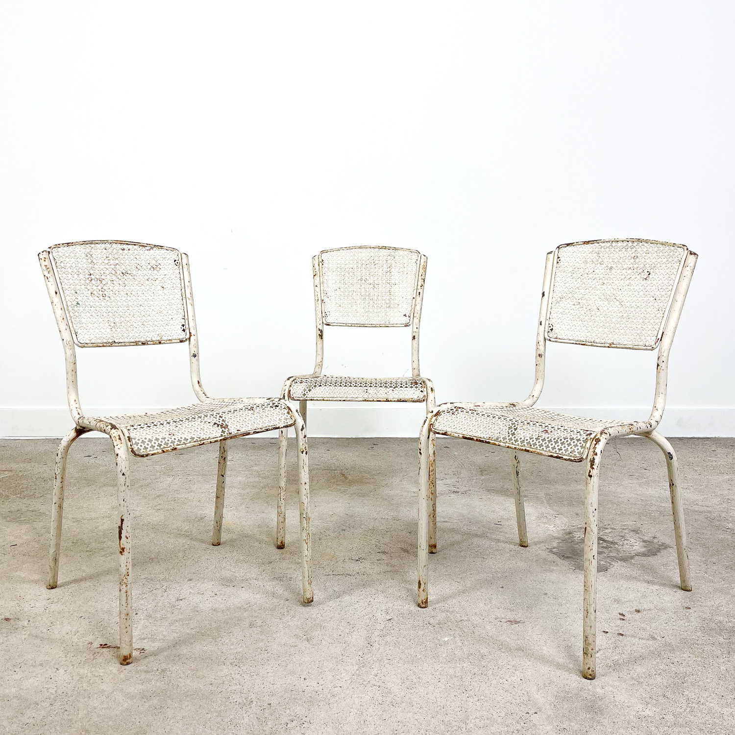 Set of three vintage industrial bistro chairs by Matieu Matego