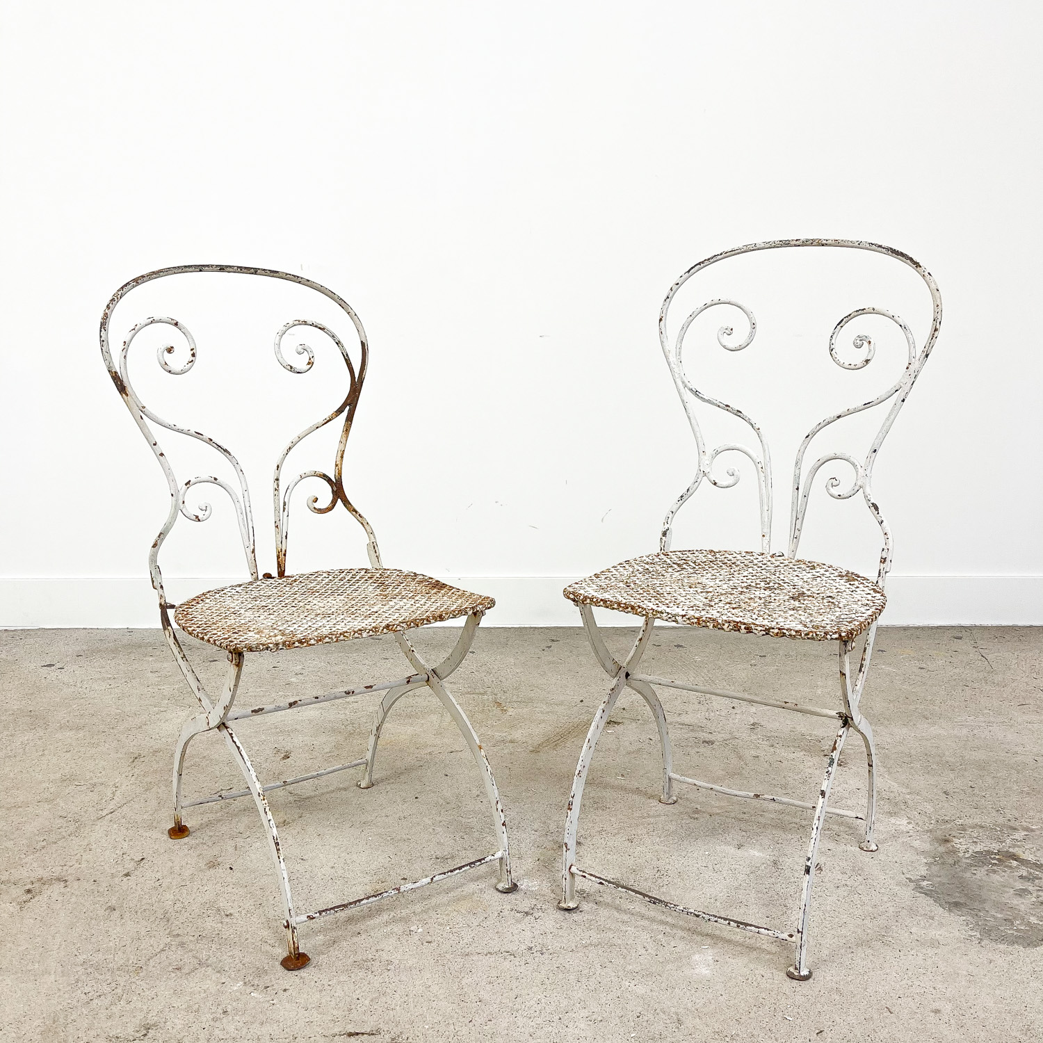 Set of two vintage foldable metal bistro chairs by Mathieu matego