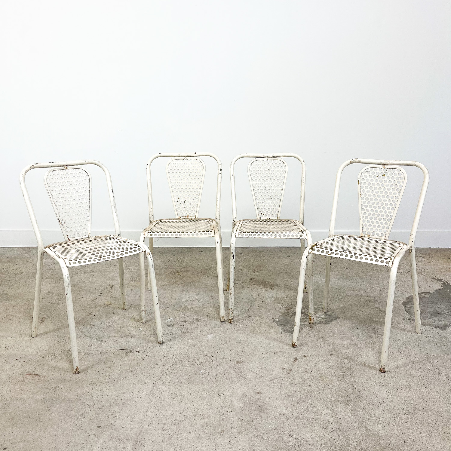 Set of four vintage industrial metal bistro chairs by Rene malaval