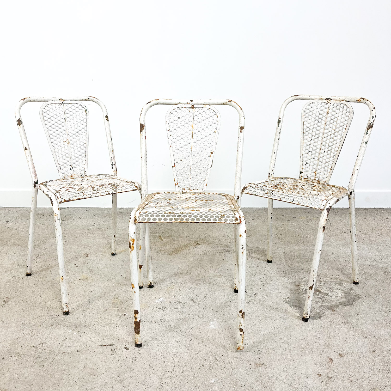 Set of three vintage industrial metal bistro chairs by Rene malaval