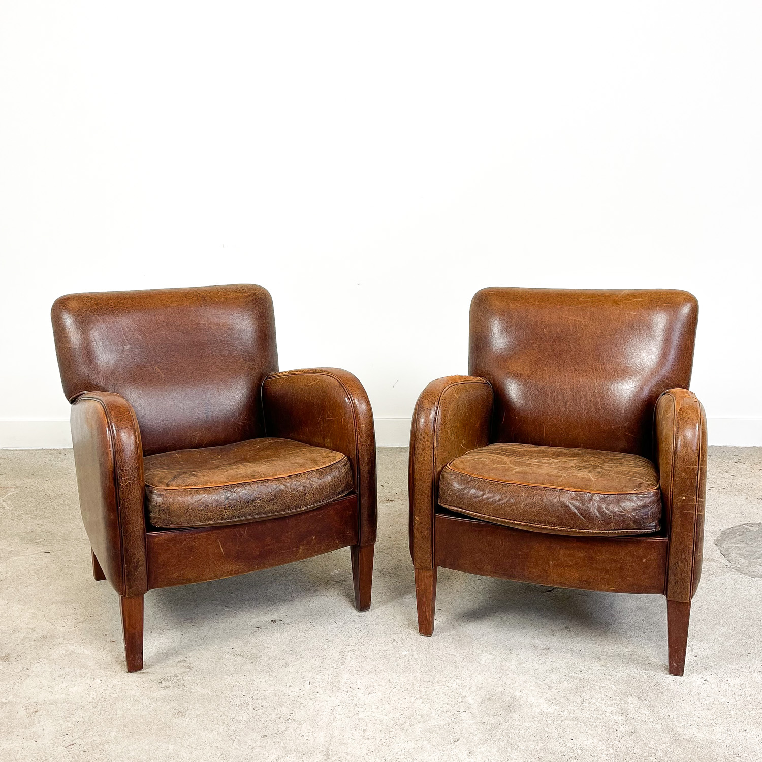 Set of two vintage sheep leather armchairs
