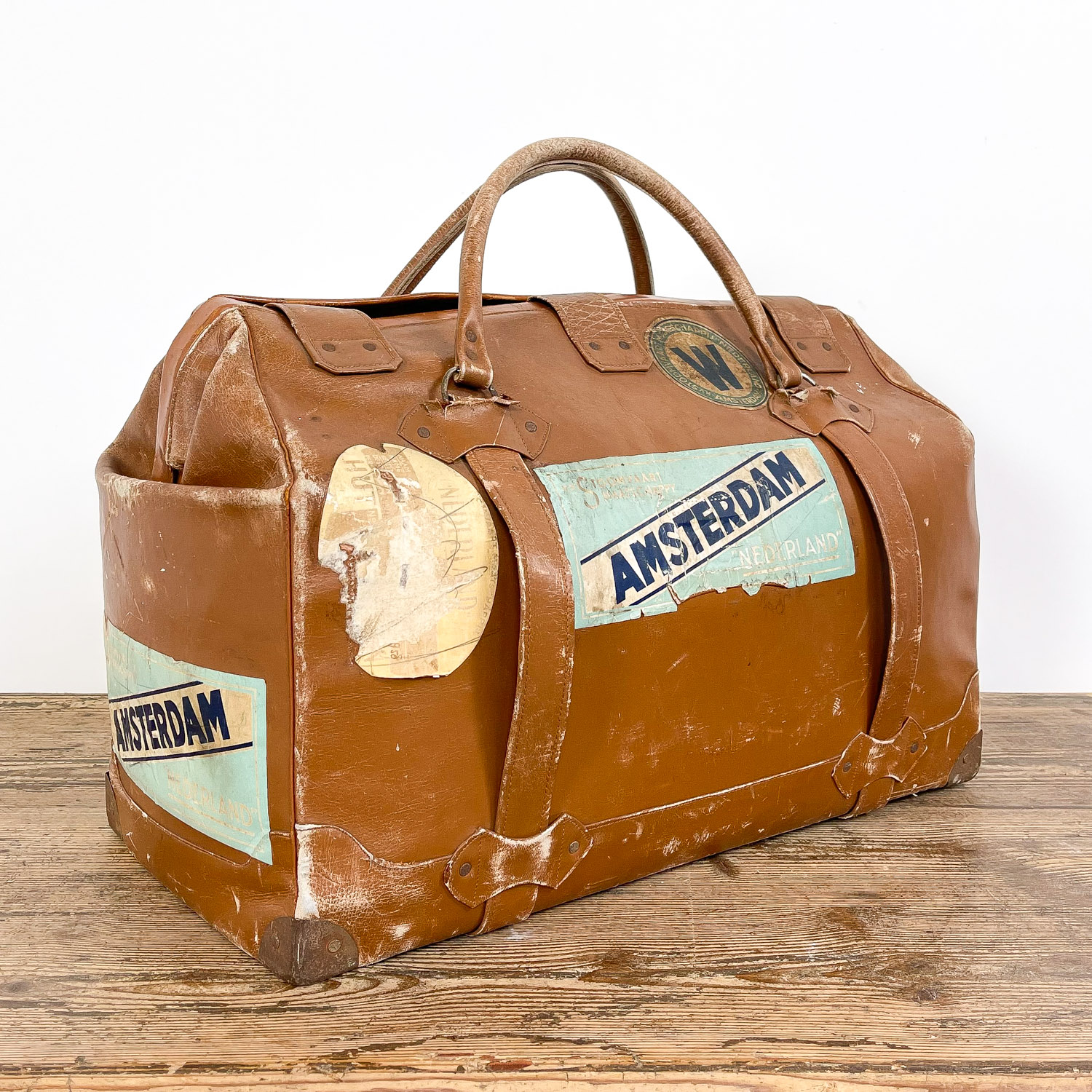 Vintage leather travel bag with Amsterdam stickers