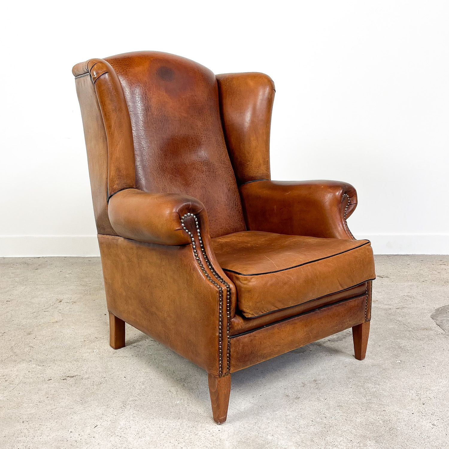 Vintage sheep leather wingback armchair