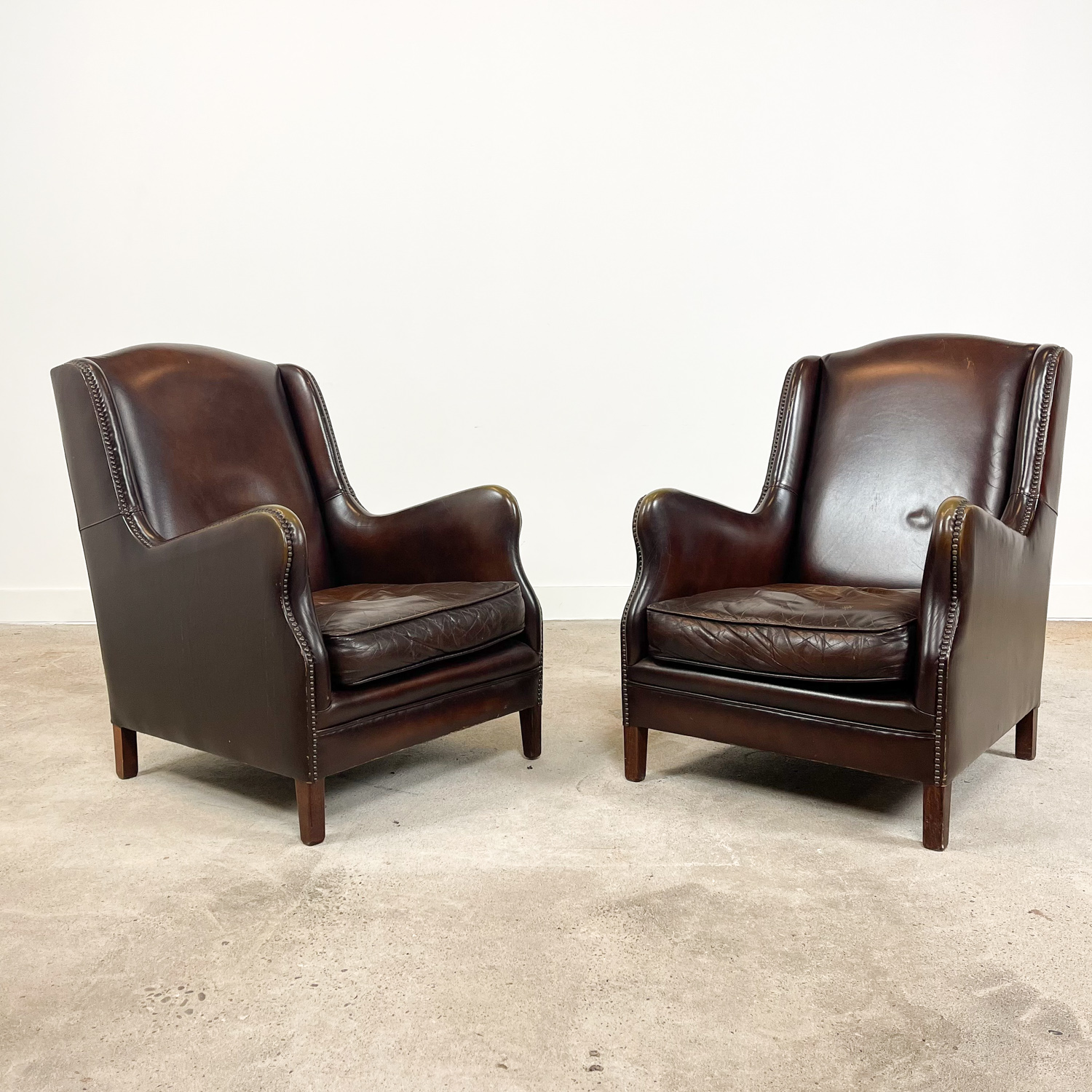 Set of two dark brown vintage sheep leather armchairs