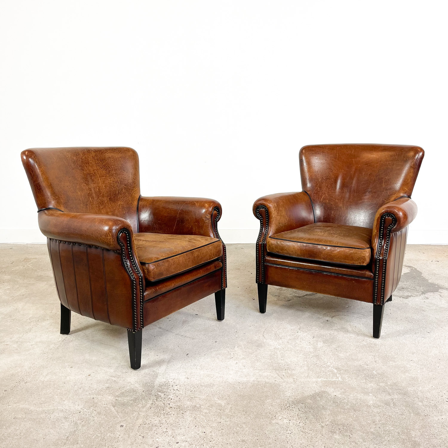 Set of two vintage sheep leather armchairs by Loung Atelier