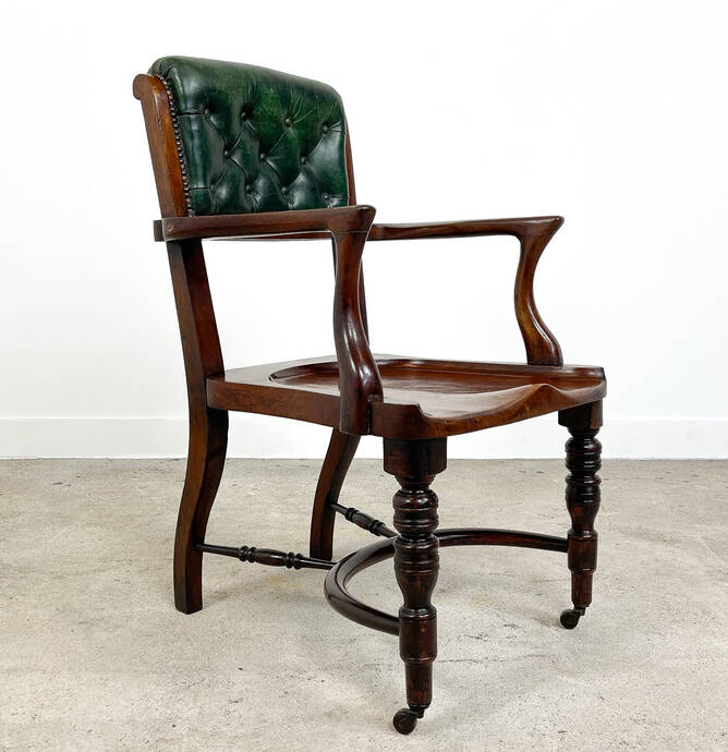 English antique mahogany and buttoned leather desk chair by Cornelius V Smith 1890s